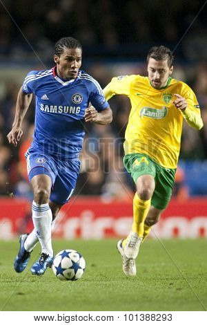 LONDON ENGLAND 23 NOVEMBER 2010. Chelsea's midfielder Florent Malouda and MSK Zilina's midfielder Admir Vladavic in action during the UEFA Champions League match between Chelsea FC and MSK Zilina
