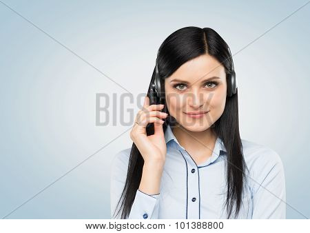 Front View Of The Smiling Brunette Support Phone Operator With Headset. Isolated On White Background