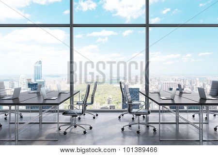 Workplaces In A Modern Panoramic Office, New York City View From The Windows. Black Tables And Black