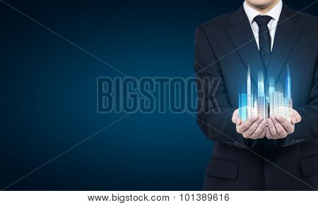 A Person Holds A Hologram Of Skyscrapers As A Symbol Of Financial Success.