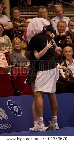 LONDON, ENGLAND. 06 DECEMBER 2009 -   Pat Rafter (AUS) gets a hug from a ball girl during the AEGON Masters Tennis, Royal Albert Hall, London.