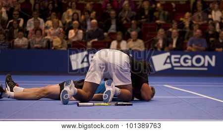 LONDON, ENGLAND. 06 DECEMBER 2009 -   Pat Rafter (AUS) comes to the aid of Stefan Edberg (SWE) by administering mouth to mouth resuscitation during the AEGON Masters Tennis, Royal Albert Hall, London.