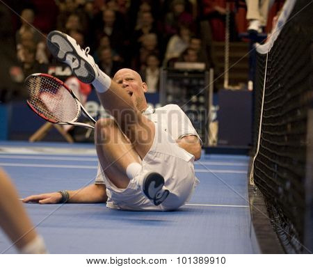 LONDON, ENGLAND. 05 DECEMBER 2009 -   Murphy Jensen (USA) hits the deck after getting a ball smashed into the midrift while competing in the season finale to the ATP Champions Tour