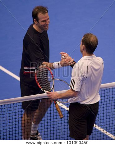 LONDON, ENGLAND. 05 DECEMBER 2009 -   Greg Rusedski (GBR) (L) congratulates Stefan Edberg (SWE) (R) after winning their preliminary match in the the season finale to the ATP Champions Tour