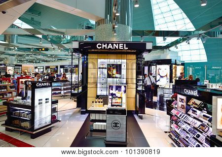 DUBAI - JUNE 23, 2015: The Dubai duty-free shopping area. Dubai International Airport is the primary airport serving Dubai and is the world's busiest airport by international passenger traffic