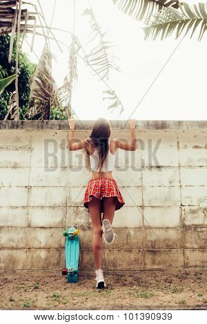 Beautiful Sexy Young Lady In Erotic Mini Skirt Trying To Get Over The Fence