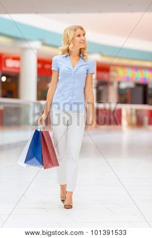 Beautiful girl shopping in a mall