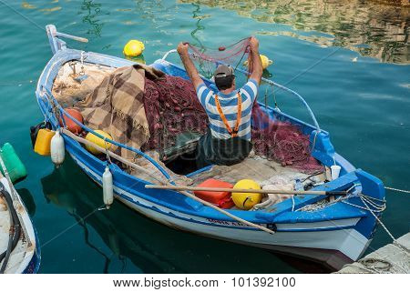 Fisherman In Greece