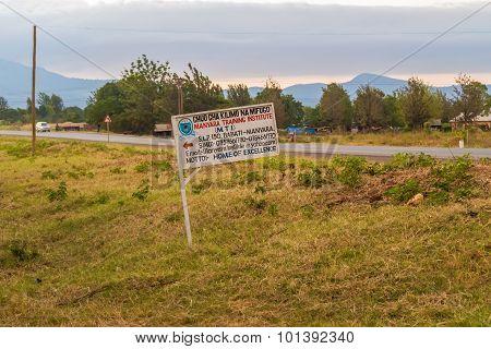 Sign At The Road In Tanzania