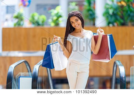 Pleasant girl making shopping