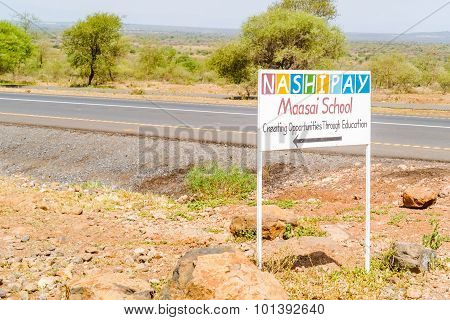 Maasai School Sign At The Road In Tanzania