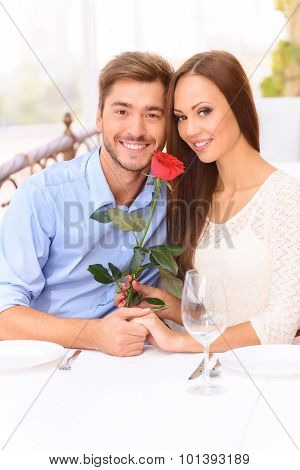 Nice couple sitting at the table