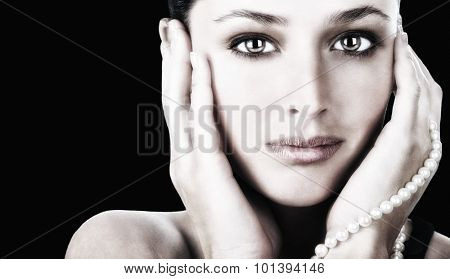 Beautiful Image of a Latino Woman with pearls on Black