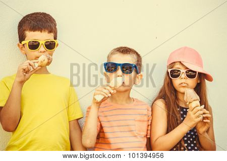 Kids Boys And Little Girl Eating Ice Cream.