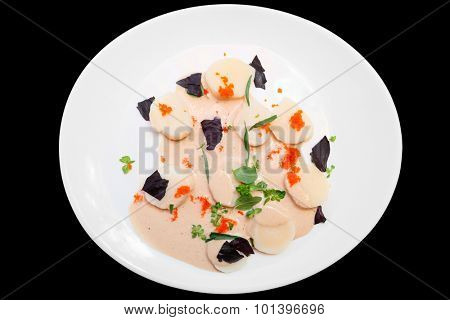 Scallop carpaccio with flying fish roe, meal rich in protein, isolated