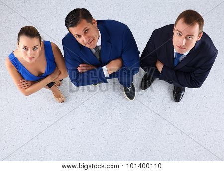 Business people standing together looking up - topview