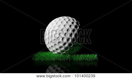 Golf ball on green turf patch, isolated on black background