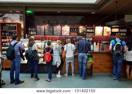 DUBAI, UAE - JUNE 23, 2015: Starbucks cafe interior. Starbucks Corporation, doing business as Starbucks Coffee, is an American global coffee company and coffeehouse chain based in Seattle, Washington