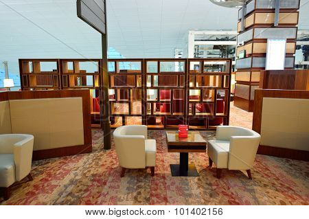 DUBAI - JUNE 22, 2015: Emirates business class lounge interior. Emirates is the largest airline in the Middle East. It is an airline based in Dubai, United Arab Emirates.