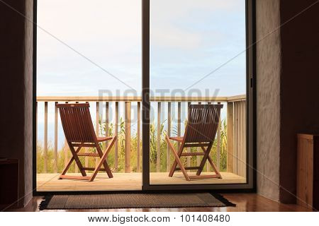 Two chairs on holiday villa terrace