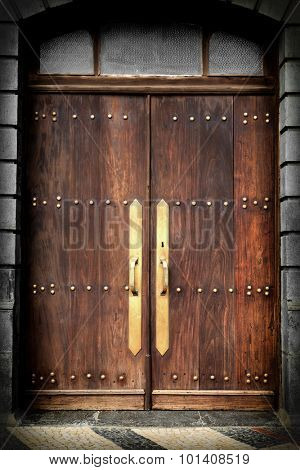Old vintage wooden door with metal design