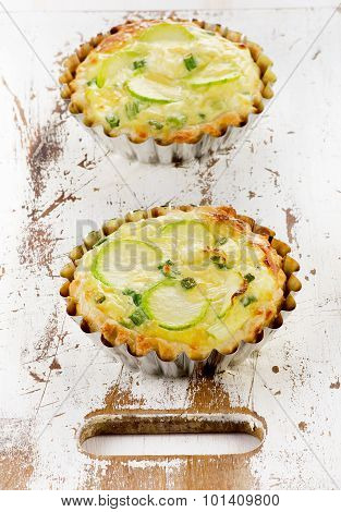 Two Tarts With Zucchini And Cheese