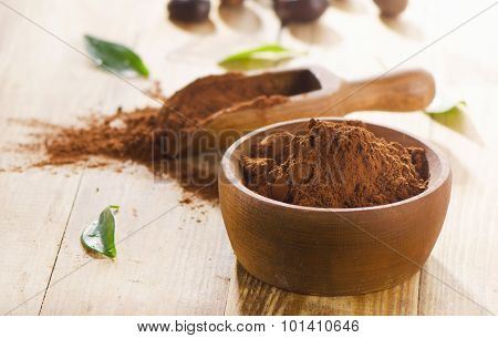 Cacao Powder In  Wooden Bowl.