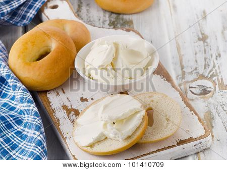 Bagels With Cream Cheese On  Wooden Table.