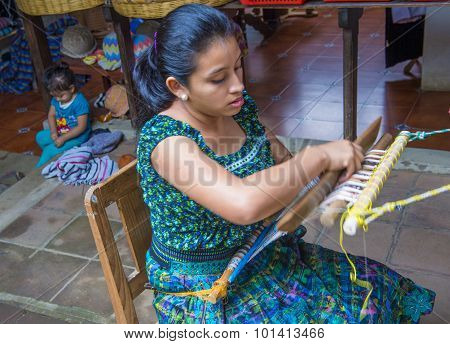Peruvian Man Weaving