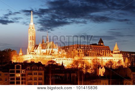 Matthias Church And Fisherman's Bastion Over The Danube River At Night. Budapest, Hungary.