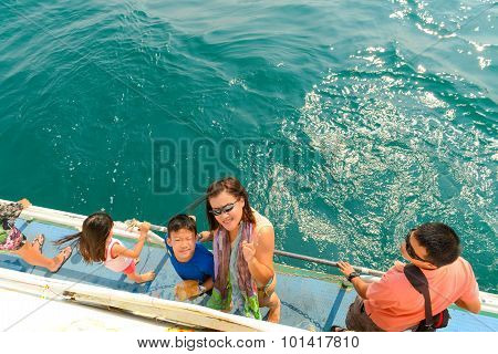 Mother And Children Are Going To Dive In Summer