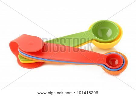 Colorful Plastic Measuring Spoon On White Background
