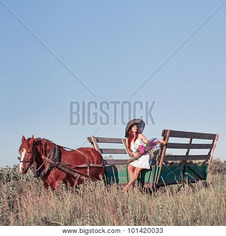 Pretty Girl With Wildflowers On The Horse Carriage In Summer Day, Outdoors. Series