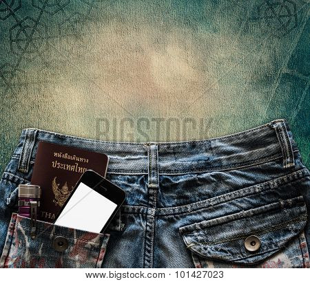 Blue Jeans With Cell Phone, Flashlight And Passport In A Pocket Background