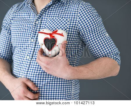 Young Man Holding A Heart. Valentine's Day.