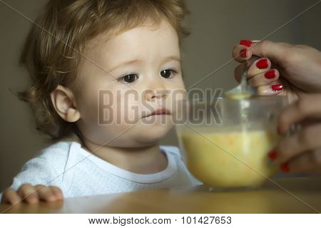 Little Cute Boy Eating Soup