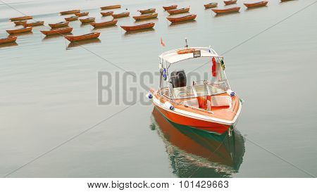 Red speedboat and recreational boats