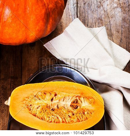 Autumn Pumpkin On Wooden Table With Yellow Leaves. Beautiful Autumn Pumpkin Thanksgiving Background