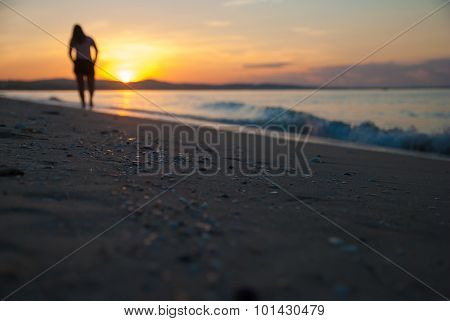 Dawn of the sand and the silhouette of the girl