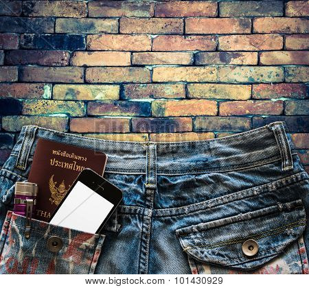 Blue Jeans With Cell Phone, Passport And Flashlight In A Pocket Background