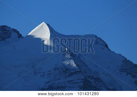 Pointed Mountain Peak Next To Mt Jungfrau
