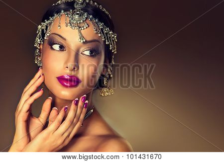 Beautiful Indian woman portrait with jewelry . elegant Indian girl looking to the side with  traditi