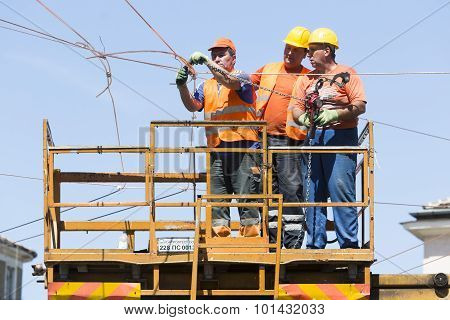 Electricity Cpnstruction Workers On A Platform