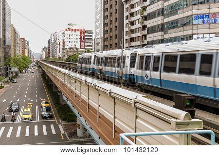 Taipei Mrt On The Rail And City Street
