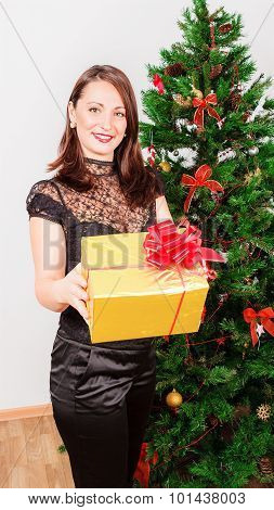 Beautiful woman with big gift box