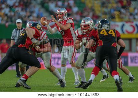 VIENNA, AUSTRIA - JUNE 7, 2014: QB Christoph Gross (#8 Austria) catches the ball.