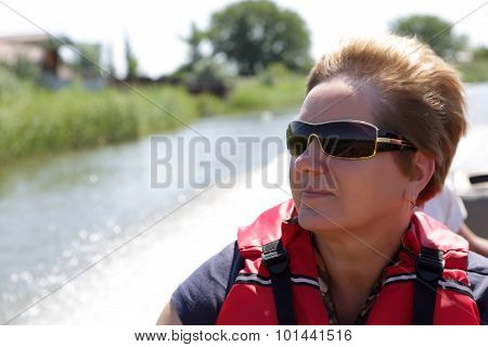 Senior Woman Resting In Boat