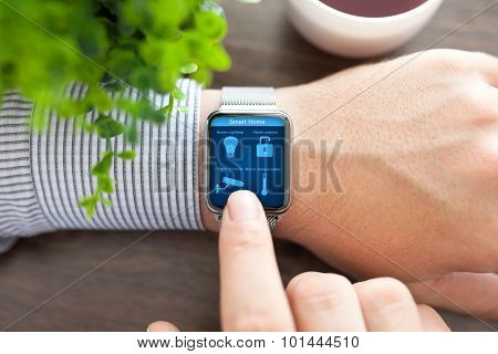 Man Hands In Watch With Program Smart Home On Screen