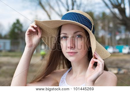 Freckled Happy Girl Holding Hat And Looking At Camera