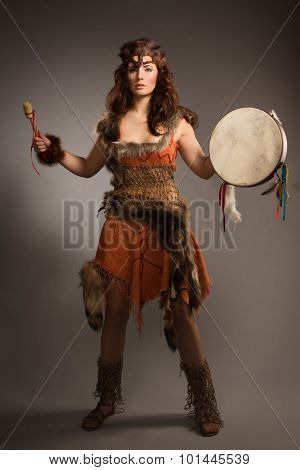Shaman Woman With A Tambourine In Studio